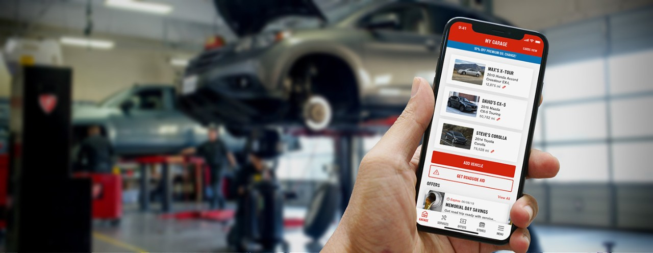 Hand holding mobile device showing Firestone Complete Auto Care mobile app